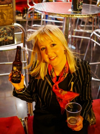 Laura enjoying Brewfist's Galaxie, a Chardonnay Barrel Aged Saison; outside Beer 4 Bunnies